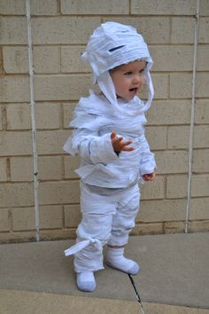 Make an easy halloween costume with a bed sheet that screams mummy how to make an easy no sew childs mummy costume toddler boy halloween solutioingenieria Images