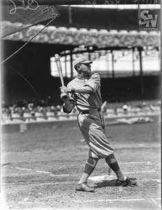 May 6, 1915 - Boston Red Sox Babe Ruth hit his first major league home run. The game was also his pitching debut.  Boston Red Sox Babe Ruth batting in 1918.  (Charles M. Conlon / Sporting News)