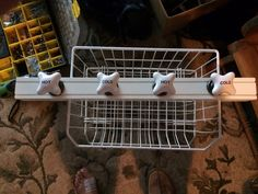 DIY bathroom shelf made from a table leg from Lowes and knobs from Hobby Lobby.
