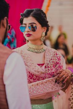 Bridal Portrait- Bride in a Choker Gold Necklace with Hanging Emeralds and Pearls | WedMeGood #wedmegood #indianbride #indianwedding #bridal #pink #bridalportrait