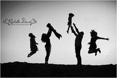 Fun family shot. Everyone in the air! Large family posing.