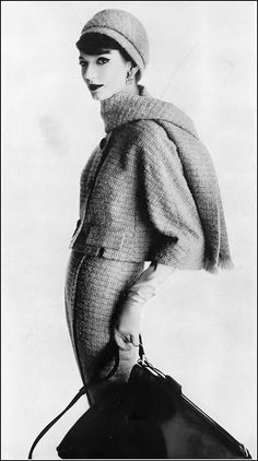 Simone D'Aillencourt in suit and scarf by Harry Frechtel, matching hat by Emme for Harper's Bazaar, January 1959