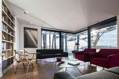 Image 24 of 38 from gallery of House in Crozon & Agence d& Pierre-Yves Le Goaziou. Photograph by Pascal Léopold Red Cedar Wood, Minimalist Furniture, Commercial Architecture, Architect House, Made In France, Contemporary Architecture, Minimalist Architecture, Concrete Floors, Home Interior Design