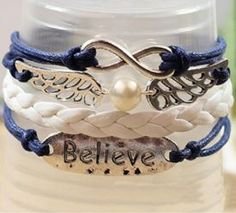 Love this Believe Wrap Bracelet! Navy Blue and White Chic Faux Pearl and Wing…