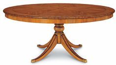 "TULA DINING TABLE 180 No: 528.867.02  70-7/8""Dia x 30-1/8""H  Hand-carved pedestal dining table in primavera solids with saber legs.  Available in 02 Frutal, 06 Mahogany, 08 Cognac, and 36 Deleware (Walnut) finishes.  Also available as  Tula Expanding Dining Table 180 No: 528.868.02 98-1/2""W x 70-7/8""D x 30-1/8""H when expanded"