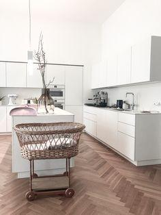 White minimal kitchen Viennese house built in 19th century.