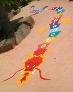 Ground Painted Multi-coloured Alphabet Dragon.