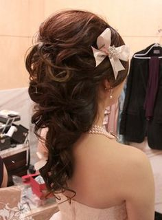 Pretty half-up do. Maybe with a sparkly barrette instead of a bow.