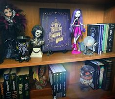 "Mhara's World on Instagram: ""A different photo to usual. But a mish mash shelf that features a few of my favourite things! The phantom manor decrypted book from…"""