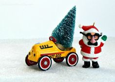 Santa in disguise with his hot rod peddle car bringing home the tree for the Christmas trees on cars blog hop.