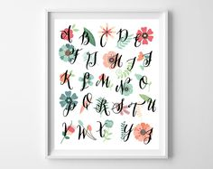 Hello, hello! Today's free printable combines colorful flowers with a fun and bold calligraphy font–perfect for a nursery or little girl's room. You can download it here. Tha…