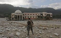 A member of the rescue operation team of Sashastra Seema Bal (SSB) or Armed Border Force walks towards the officers training centre damaged by floods at their campus in Srinagar in the Himalayan state of Uttarakhand June 19, 2013. REUTERS/Danish Siddiqui Posted by floodlist.com #floods #uttarakhand