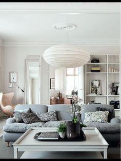 Soft grey couch, paper lantern pendant light