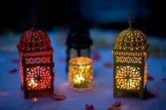Small lamps with votives for lounge area tables.