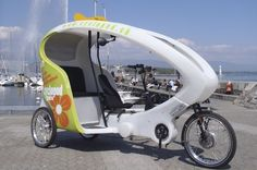 """Take a spin in Geneva, Switzerland in a """"cyclopod."""" - photo from geneve-tourisme;  """"Relax while your guide pedals, and, sheltered from wind and rain, discover the city, travelling peacefully at your own pace. The driver of this entirely original and environmentally-friendly means of transport provides you with interesting information in French or English."""""""