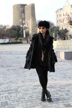 "Black ""Darcie"" Doc Martens with a Russian fur hat and fur coat."