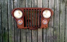 JEEP LOVER  This vintage Jeep grill is loaded with rustic charm. Richly rusted to perfection! Its been thoroughly cleaned, sealed and amended with new UL APPROVED electrical components. This old grille is ready to display with all electrical professionally connected and hidden out of sight. There is a new medium base porcelain socket in each of old headlamp cups both of which are controlled by a full range rotary dimmer mounted on the side/left of the grill. The parking lights/signals have…