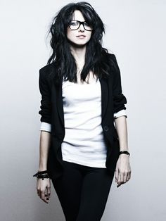 Blazer, wayfarer glasses, messy hair, black and white palette. Casual meets business casual.