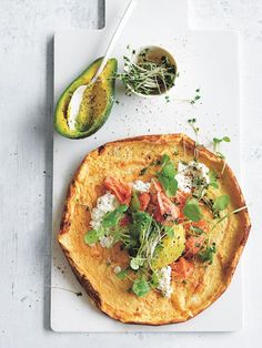 Start your Sunday right with the ultimate breakfast omelette topped with fresh watercress and avocado.