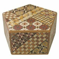 Yosegi Pentagon Puzzle Box 4 sun 6 steps by Japanese Puzzle Boxes. $99.00. This Japanese Secret / Puzzle Box is made in the Yosegi pattern. This pattern is the original traditional design used for puzzle boxes. Every box is a little different in design depending upon how the pieces are applied. Each Japanese puzzle box is individually handcrafted using techniques passed down through the generations since the Edo Period and imported directly from the artists in Hakone Japan.