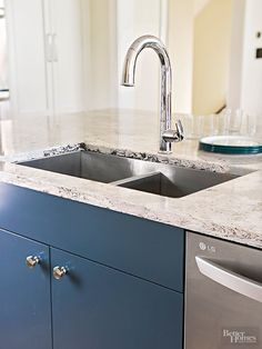 Here's a kitchen faucet you don't have to touch with messy hands. Simply wave your hand under its arc to turn it on and off.