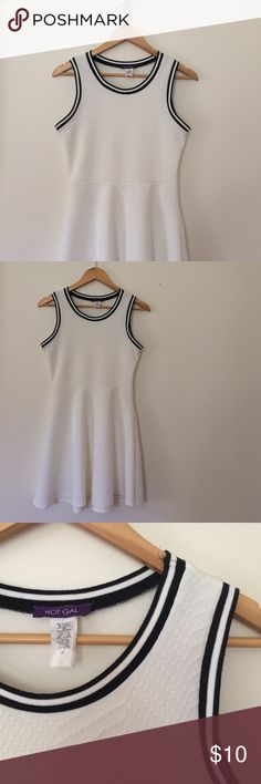 White Fit and Flare Dress with Black Detail Only worn once! Cute, sporty, white dress that it fitted to the waist and flares out. The dress itself has a knit pattern as well as black shoulder detailing. Dresses Mini