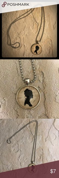 """Necklace with pendant Beautiful chain necklace with pendant. Pendant has a vintage lady's silhouette. Great condition costume jewelry. Chain is 11"""" long Jewelry Necklaces"""