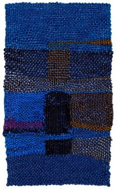 "Sheila Hicks's ""Phare d'Acier"" is a miniature created on a small wooden frame that she takes with her around the globe. By her on estimate she has made more that 1000 of them."