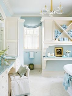 This spa-like bathroom uses gorgeous molding and partial walls to section off the space: http://www.bhg.com/bathroom/decorating/cottage/bathroom-tour-cottage-style/?socsrc=bhgpin030815allinthedetails&page=8