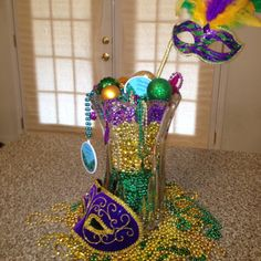 Mardi Gras decoration with beads, ornaments, vase and masks!