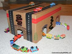 Turn a cradboard box into a race track and tunnel.  Perfect for your Train-Loving, Car-Racing Kid