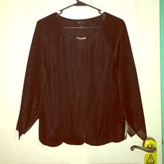 Black Formal Shirt The short is black with light golden streaks that go through it. It has a nice golden necklace attached to it and a little V-neck. It would be perfect for wearing to a meeting or a concert. It has never been worn, it still has the tag, and it is the size small but runs a little bigger so like a small + .25. ❣❤️ BCX Tops Tees - Long Sleeve
