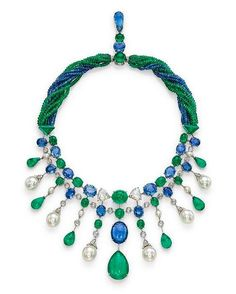 "Titled the ""Persepolis"" fringe necklace, the elegant Cartier jewel has alternating cabochon emeralds, oval-cut sapphires and rose-cut diamonds set in two lines. Then come the suspending lines of cultured pearls, emeralds and diamonds which become larger with the descent, all this beautifully attached to strings of sapphires and emerald beads. Most of the emeralds are of Colombian origin and the sapphires, Ceylon. Something unforgettable about the pattern in this necklace we discovered at…"