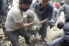 People free a man from the rubble of a destroyed building after an earthquake in Kathmandu,Nepal. A earthquake rocked Nepal destroying buildings in Kathmandu and surrounding areas. Nepal, Tibet, United States Geological Survey, New York Post, Vulnerability, Mount Everest, Asia, Death, Socialism