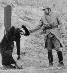 Execution of Mata Hari in France after she was charged with spying for Germany during World War I .