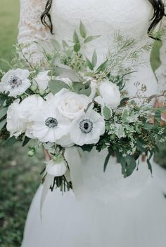 A winter favorite, white anemones are perfect for this bridal bouquet from Bloominous.