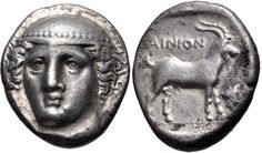 Tetradrachm from Ainos, Thrace c. 382 - 379 BC. Head of Hermes facing slightly left, wearing petasos. On the reverse, a goat standing right; AINION above; trophy to right; all within incuse square.Ainos (modern Enez in Turkey) was an ancient Greek city on the southeastern coast of Thrace.