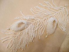 Bead embroidery: White peacock feather