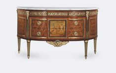 COMMODE DEMI-LUNE en marqueterie ouvrant à trois tiroirs en ceinture. Estampillée RVLC. Roger Vandercruse dit Lacroix (1727-1799). Epoque Louis XVI.