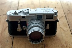 A Leica M3 - single stroke - with a 50mm Summicron lens. Pine.