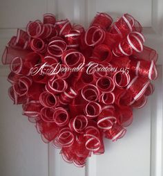 This Heart Shaped Wreath is so A-DOOR-ABLE!!! Made with deluxe metallic red & white deco mesh and solid red deco mesh. Measures approx. 21X 23 Very durable mesh to weather. ***OTHER COLORS AVAILABLE IN THIS BEAUTIFUL HEART WREATH***  CLICK ON LINK BELOW FOR GREAT GIFT IDEAS!   ***Made in a smoke-free home***  ***SHIPPING: 1-3 Business days from order date. USPS. I do ship and wire in all my wreaths. The boxes are perfect for storing your wreath in when you are not displaying it. SOME…