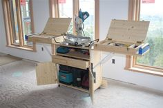 Miter saw stand with fold up sides made of pine & finished with Varathane. Swivel casters for moving, tools are stored in 2 tool boxes that get attached to the fold up side wings, the tool boxes...