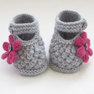 These pretty little shoes / bootees have been knitted with lovely wool blend yarn.   They are adorable in silver grey with raspberry pink knitted flowers finished with  tiny grey buttons.  Soft and comfortable for your baby - Ideal for wearing in the c...