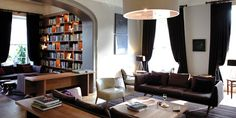 love the space planning: bookcase, large lamp, curtains