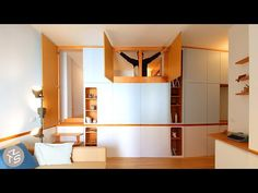 Inspired by the tightly designed interiors of sailing boats, llabb architecture converted this 70's open plan studio apartment into a two bedroom home without expanding its 35sqm footprint.