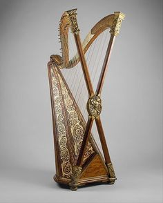 Double Chromatic Harp built by Henry Greenway around 1895.    Towards the end of the 19th c. the English-born American harp builder Henry Greenway built several copies of his peculiar cross-strung chromatic harp model featuring X-shaped pillar and two necks. The one in the picture is displayed at the Metropolitan Museum in New York City.