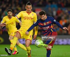 Barcelona's Argentinian forward Lionel Messi vies with Sporting Gijon's midfielder Mandi during the Spanish league football match FC Barcelona vs...