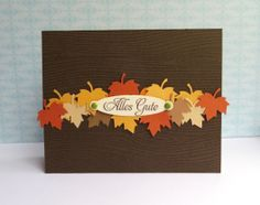 handmade greeting card ... Autumn theme ... chocolate card base stamped with woodgrain ... band of punched maple leaves runs across the card ... sentiment tag on top ... luv this card!!
