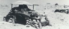 An Sd.Kfz. 223 in the North African desert. As with much of the equipment that went with the initial Afrikakorps force, it is not specialized for desert warfare, still wearing the dark grey paint job. (Bundesarchiv), pin by Paolo Marzioli