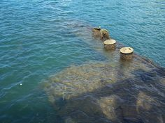underwater remains of USS Arizona  the men that died there remain in what became their burial tomb.